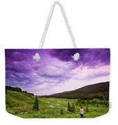 A Person Stand In A Field Watching Weekender Tote Bag