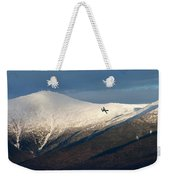 A Plane Flies In The Distance Over Mt Weekender Tote Bag