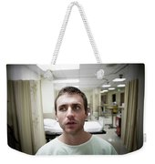 A Portrait Of A Young Man Sitting Weekender Tote Bag