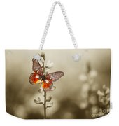 A Red Butterfly On The Moody Field Weekender Tote Bag