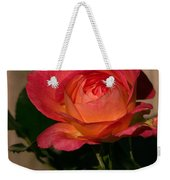 A Red Rosr Against A Weathered  Wood Background Weekender Tote Bag