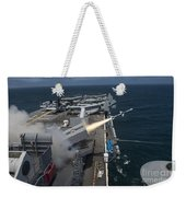 A Rim-7 Sea Sparrow Missile Is Launched Weekender Tote Bag by Stocktrek Images