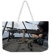 A Sailor Fires An M-240b Machine Gun Weekender Tote Bag by Stocktrek Images