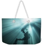 A Scuba Diver Ascends Into The Light Weekender Tote Bag by Michael Wood