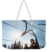 A Skier And Snowboarder Share The Chair Weekender Tote Bag