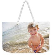 A Smiling Young Boy Enjoys A Sunny Weekender Tote Bag