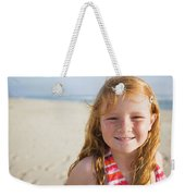 A Smiling Young Girl Enjoys A Sunny Weekender Tote Bag
