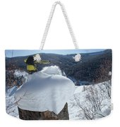 A Snowboarder Jumps Off A Cliff Weekender Tote Bag