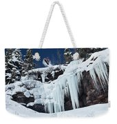 A Snowboarder Jumps Off An Ice Weekender Tote Bag