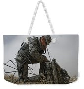 A Soldier Communicates Using A Weekender Tote Bag