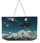 A Ufo Flying Over A Mountain Range Weekender Tote Bag