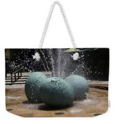 A Water Fountain With Dinosaur Eggs In The Universal Studios Singapore Weekender Tote Bag