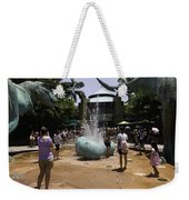 A Water Fountain With Dinosaur Eggs In Universal Studios Singapore Weekender Tote Bag
