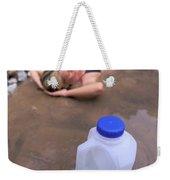 A Water Jug Near A Woman Soaking Weekender Tote Bag