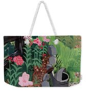 A Watering Can And A Shovel By A Flower Bed Weekender Tote Bag