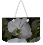 A White Orchid Flower Inside The National Orchid Weekender Tote Bag