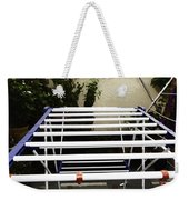 A White Plastic Stand For Hanging And Drying Clothes Weekender Tote Bag