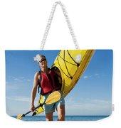 A Woman Carrying Her Sea Kayak Weekender Tote Bag