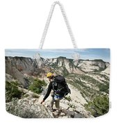 A Woman Cautiously Navigates A Steep Weekender Tote Bag