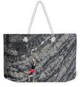 A Woman Climbs Above Her Protection Weekender Tote Bag