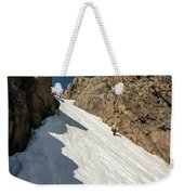 A Woman Descending A Snow Slope While Weekender Tote Bag