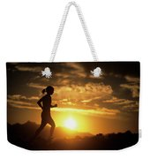 A Woman Jogs Under Sunset Weekender Tote Bag