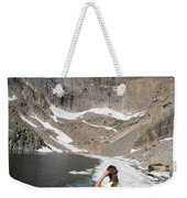 A Woman Looks Across A Partially Frozen Weekender Tote Bag