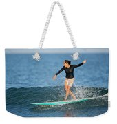 A Woman Rides A Wave On A Longboard Weekender Tote Bag
