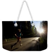 A Woman Running On A Country Road Weekender Tote Bag