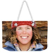 A Woman Stands Against A Log Cabin Weekender Tote Bag