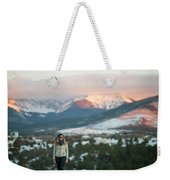 A Woman Stands Against A Snowy Mountain Weekender Tote Bag