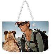 A Woman  Talks To Her Dog While Taking Weekender Tote Bag