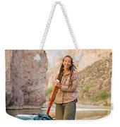 A Woman Unloads Gear From Her Canoe Weekender Tote Bag