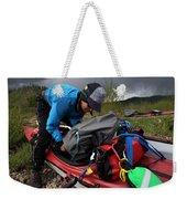A Woman Unloads Her Kayak Weekender Tote Bag