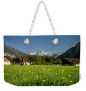 A Woman Walks Through An Alpine Meadow Weekender Tote Bag