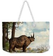A Woolly Rhinoceros Trudges Weekender Tote Bag by Daniel Eskridge