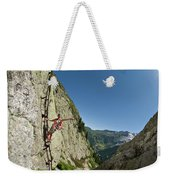 A Youg Woman Poses On A Ladder Bolted Weekender Tote Bag