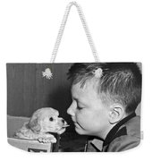 A Young Boy Is Face To Face With A Puppy Tongue. Weekender Tote Bag