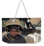 A Young Boy Wears A Coalition Force Weekender Tote Bag