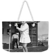 A Young Girl Hits A Golf Ball Weekender Tote Bag