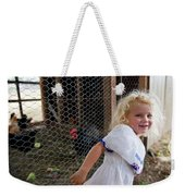 A Young Girl Shows Off Her Familys Weekender Tote Bag