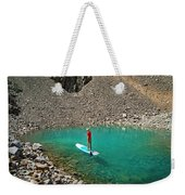 A Young Male Paddleboarding On A Small Weekender Tote Bag