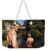 A Young Man And Woman Pause Weekender Tote Bag
