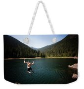 A Young Man Jumps From A Ledge Weekender Tote Bag