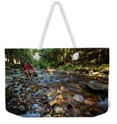A Young Man Watches A Shallow River Weekender Tote Bag