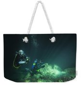 A Young Married Couple Scuba Diving Weekender Tote Bag by Michael Wood