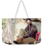 A Young Rock Climber Puts On A Climbing Weekender Tote Bag