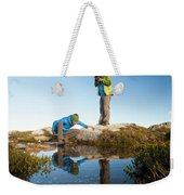 A Young Woman Explores The Microclimate Weekender Tote Bag