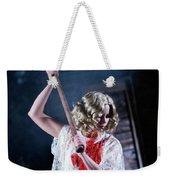 A Young Woman Holds An Axe Overhead Weekender Tote Bag