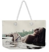 A Young Woman In A White Dress Relaxes Weekender Tote Bag
